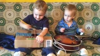 Two musicians playing a little music