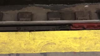 Two rats fighting for pizza subway train tracks