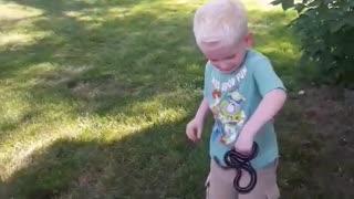 Boy Catches Garden Snake and Gets Bit