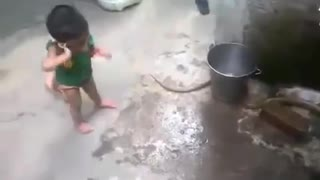 2 year baby playing with SNAKE