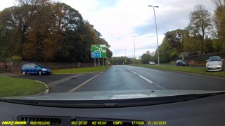 Car Nearly Spins Out into Oncoming Traffic