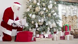 santa claus arranging gift boxes