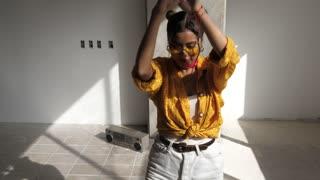 Urban trendy woman dancing