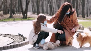 The mother and daughter have a problem with the little puppy in the park