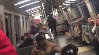 Man rides his bike through bart train
