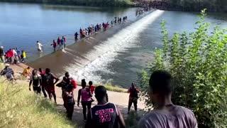 Migrants at Texas bridge pose challenge for Biden