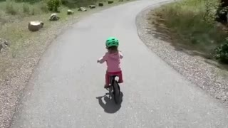 Baby Girl Riding A Bicycle