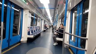 Guy Rides Bicycle in Metro Train