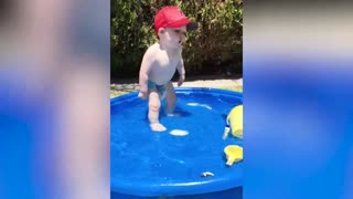 Babies swimming for the first time