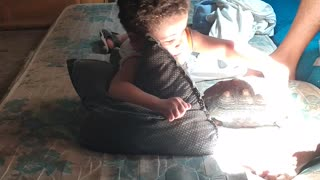 Child Playing with Turtle