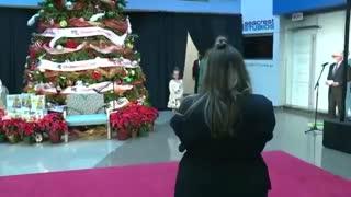 FLOTUS speaks at a children's national christmas celebration.
