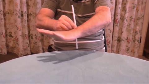 A Drinking Straw Passes Through The Arm Of A Weirdo