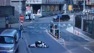 Falling Boom Barrier Knocks Scooter Rider Out Cold