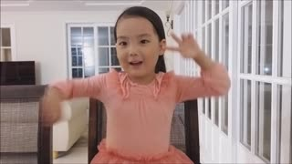 Little Girl Is Singing 'You Raise Me Up' Accompanied By A Piano