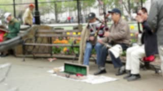 Old People Plays Music In Streets Corner