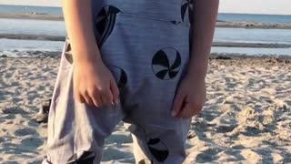 Adorable cute teen dance on beach