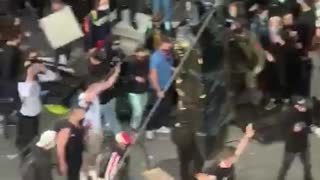 Seattle man drives into crowd, shoots protester