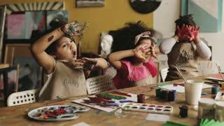Kids Showing Their Handprints