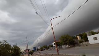 Strange storm cloud going through city.
