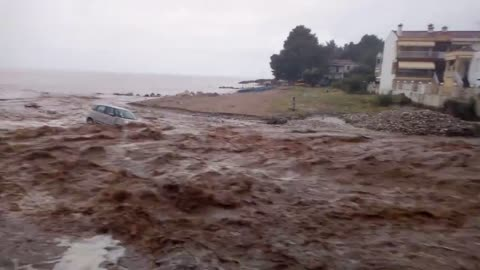 Disastrous flooding in Greece sweeps cars right into the sea