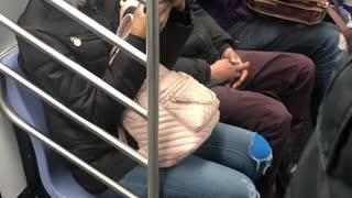Man brushes his teeth on subway train