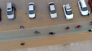 Footage Drone recording people near the beach.