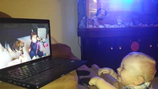 Baby laughing while watching TV