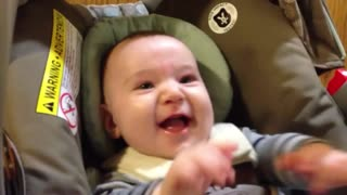Baby Sawyer laughing at duck puppet
