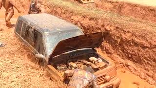 Broken car inside mud hole