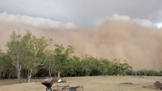 Menacing Dust Storm Sweeps over Town