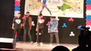 4 guys perform closer and once direction song on stage