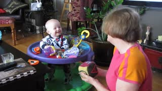 Baby Bodhi laughing at Grammie's block