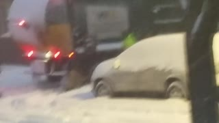 Boys Lend a Helping Hand on Their Snow Day