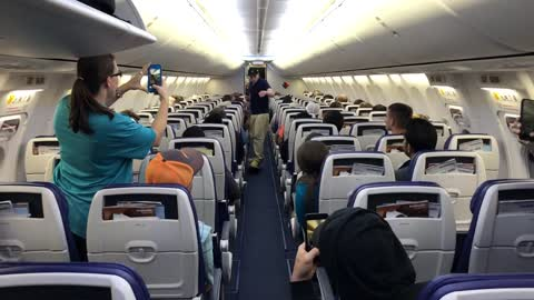 Guy Skateboards to his seat on Southwest flight!