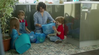 Mother Teaching Her Children About Environmental Care