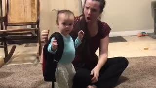 Sassy little girl adorably says NO to a hug