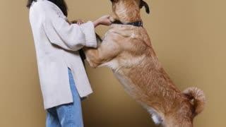 A Woman training a Dog