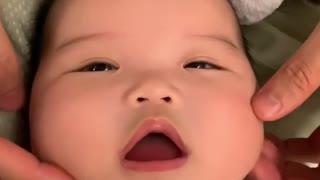 Baby Enjoys A Relaxing Face Massage
