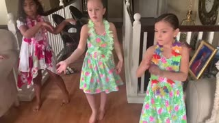 My daughter dances with her cousins.