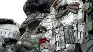 Artists create e-waste 'Mount Recyclemore' for G7