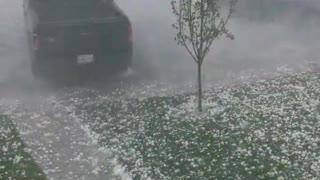 Insane video of tennis ball sized hail in Calgary