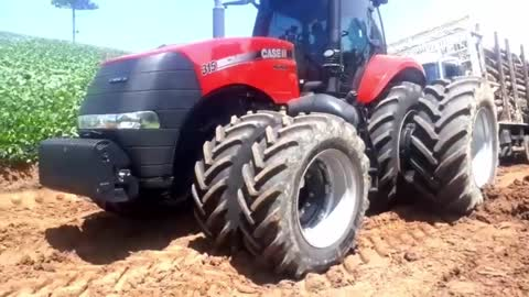 CASE tractor pulling Mercedes-Benz truck