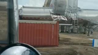 Excavator Trashes Trailer
