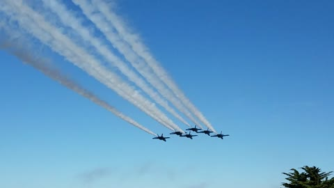 The Blue Angels Fly by the American Flag in San Francisco.