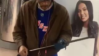 Old man hat brown jacket dancing