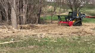 John Deere with Forestry Mower Attachment