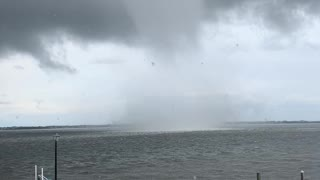 Massive waterspout forms alarming close to house