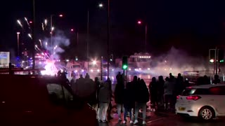 Police fire water cannon at Belfast protesters