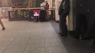 Couple and old man dance to flute dance music in subway station