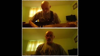 """Singing """"Down in the Valley"""" while playing my guitar and harmonica"""